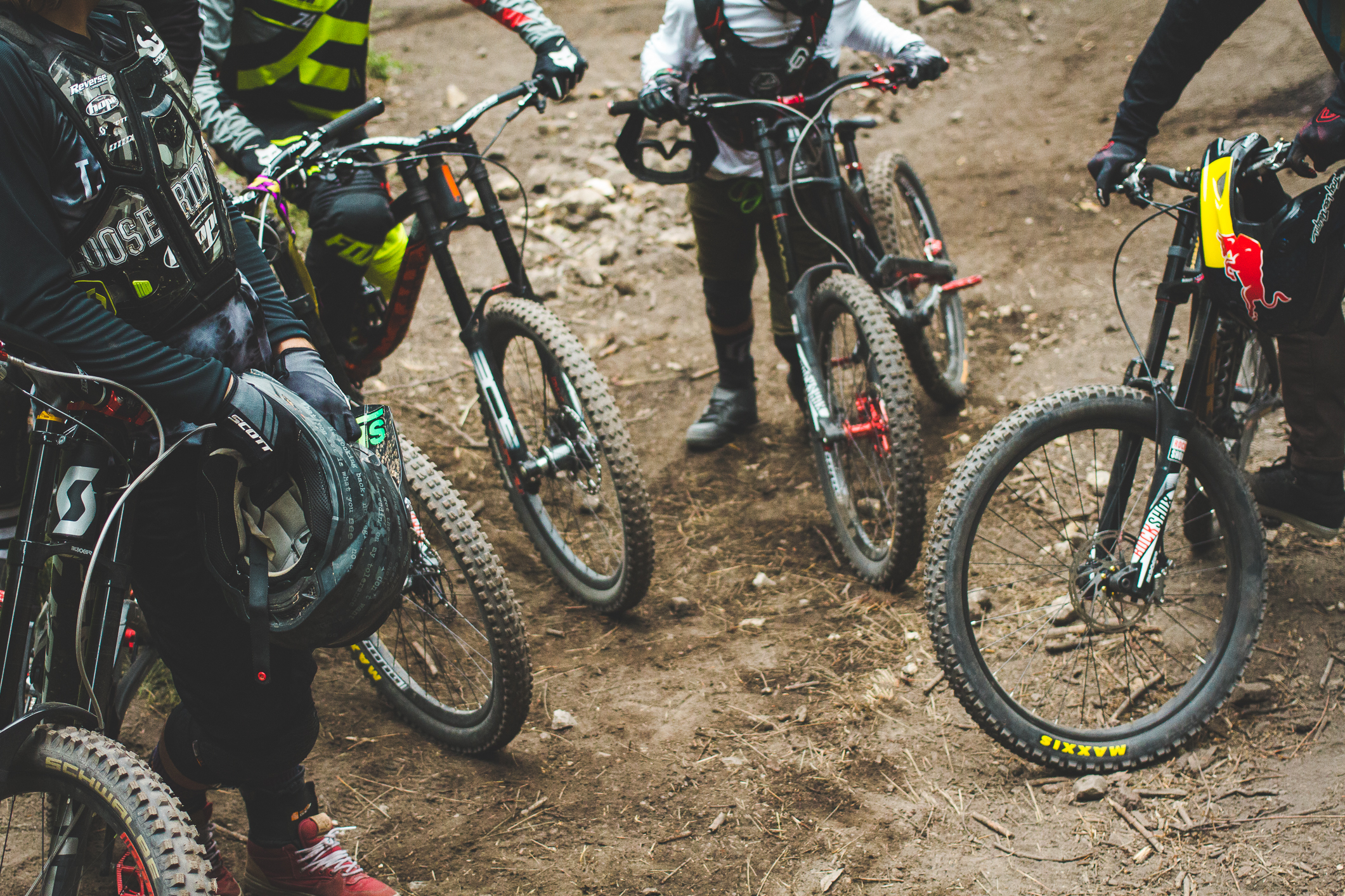 Nico Vink, Sam Reynolds, Adolf Silva and Brandon Semenuk catching some breath while hiking up their bikes to the top.