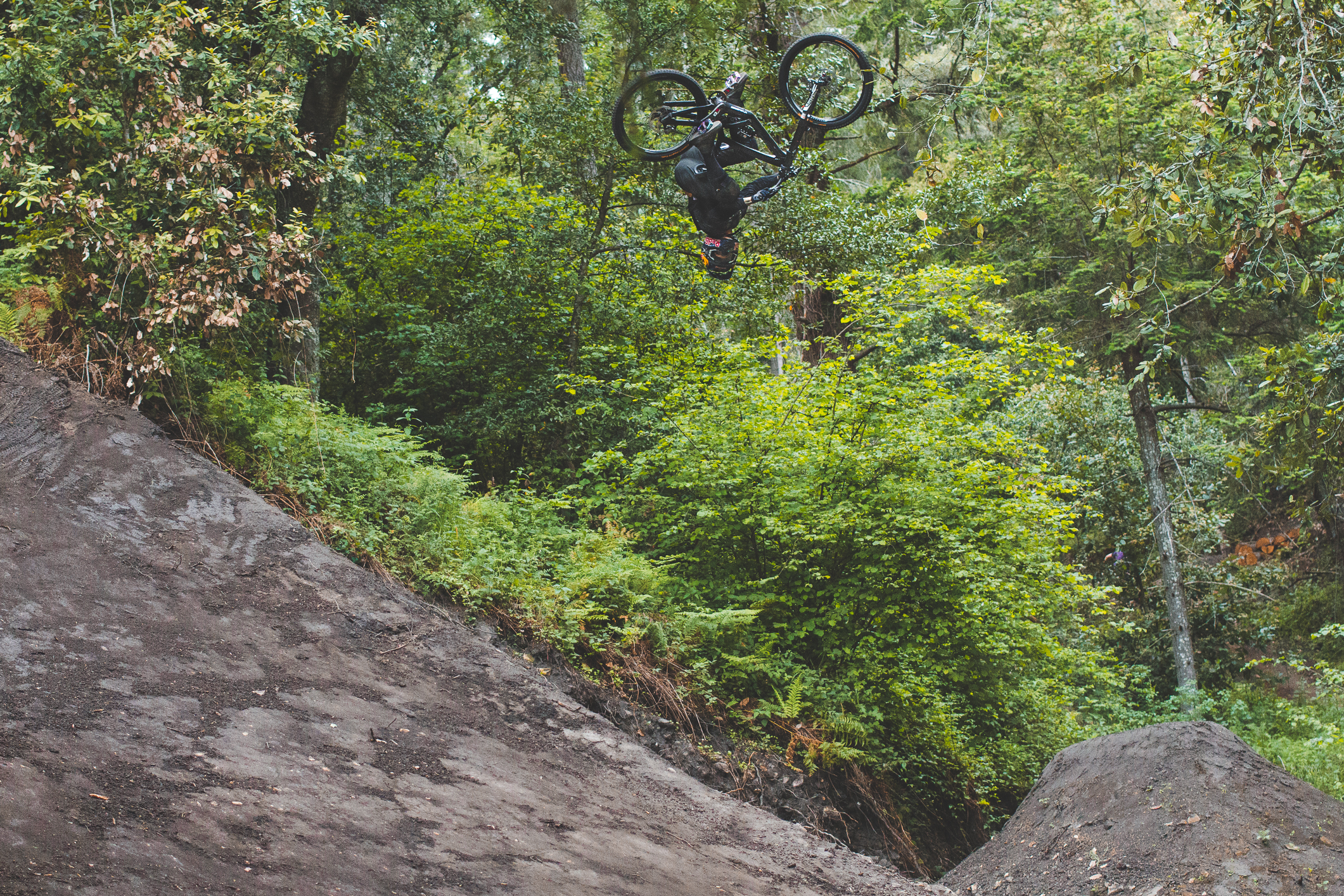 """When Andreu wasn't riding with his moto, he was spinning jumps on his 26"""" downhill bike, like this 450 over the second and biggest hip of the course."""